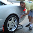Service man cleaning exterior car